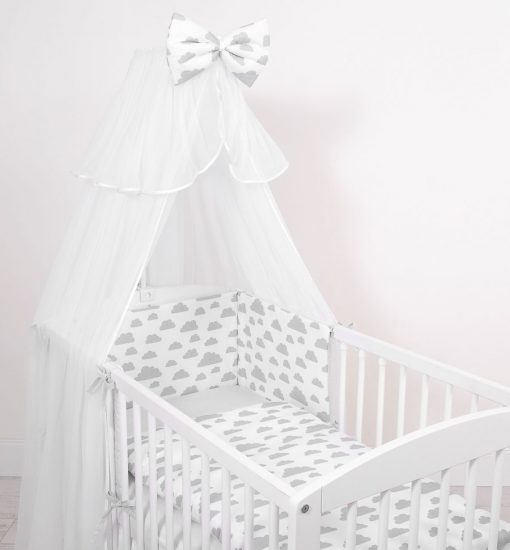 lit bébé à barreaux avec nuage